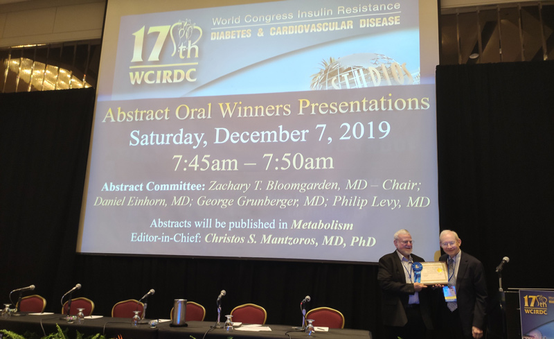 Concenter BioPharma cofounder and CSO Prof. Mottie Chevion, left, receiving his award from Dr. Zachary Bloomgarden at the World Congress on Insulin Resistance, Diabetes and Cardiovascular Diseases in Los Angeles, December 2019.